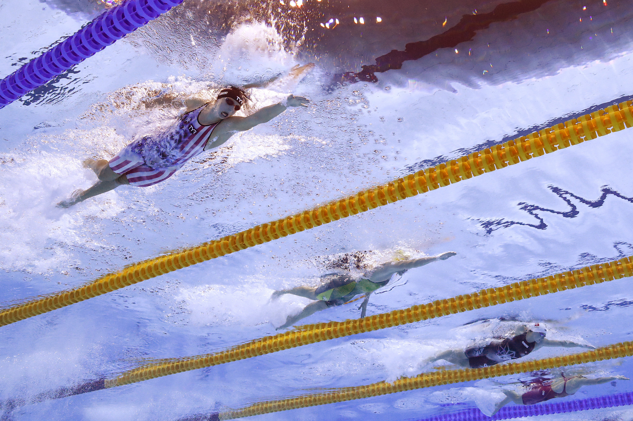 The same can be said for Ariarne Titmus, centre, after the Australian added the women's 200m freestyle gold medal to her 400m triumph  ©Getty Images
