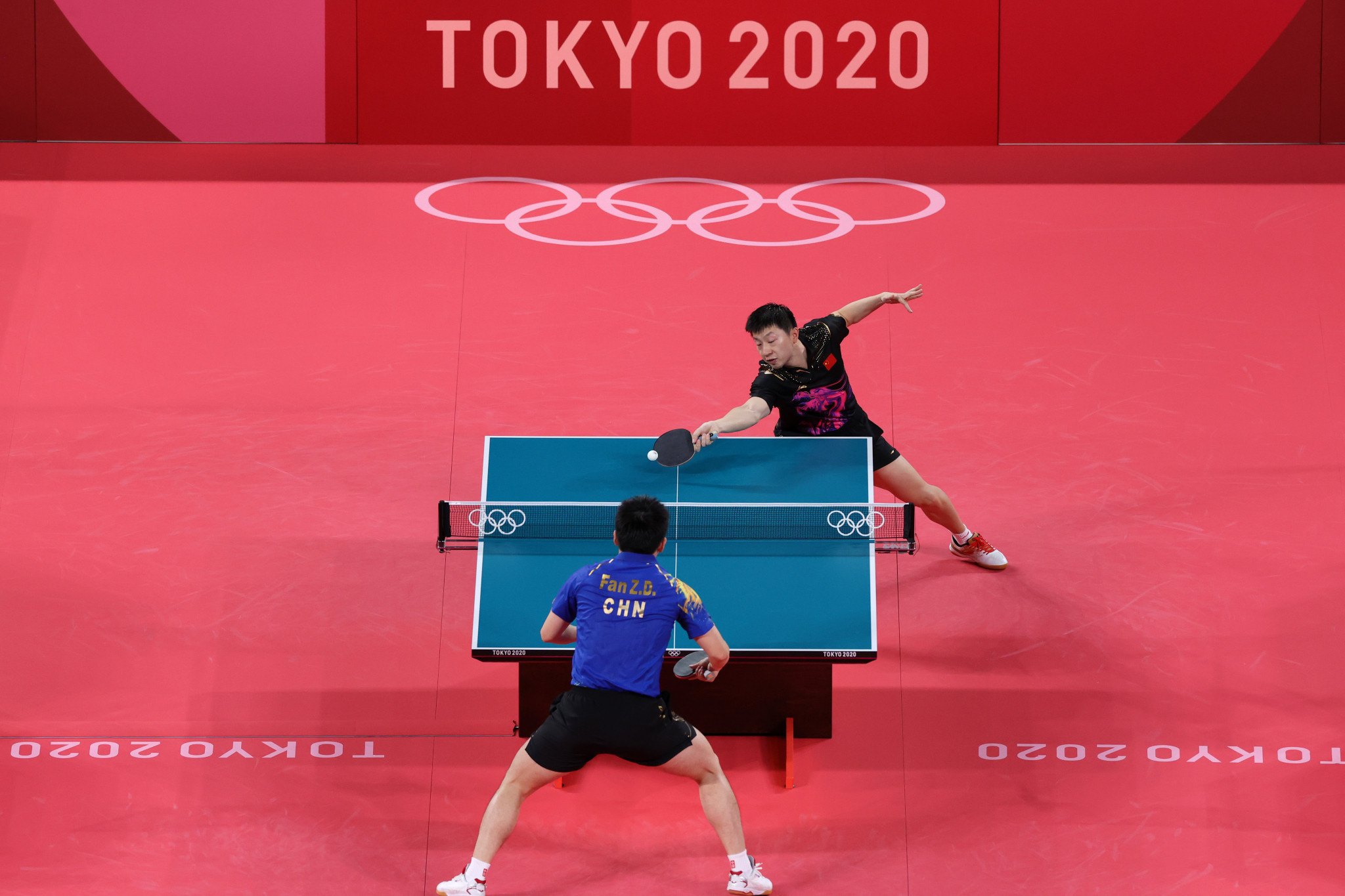 Ma Long, top, defeated Chinese compatriot Fan Zhendong to win the men's singles table tennis gold medal match in six games ©Getty Images