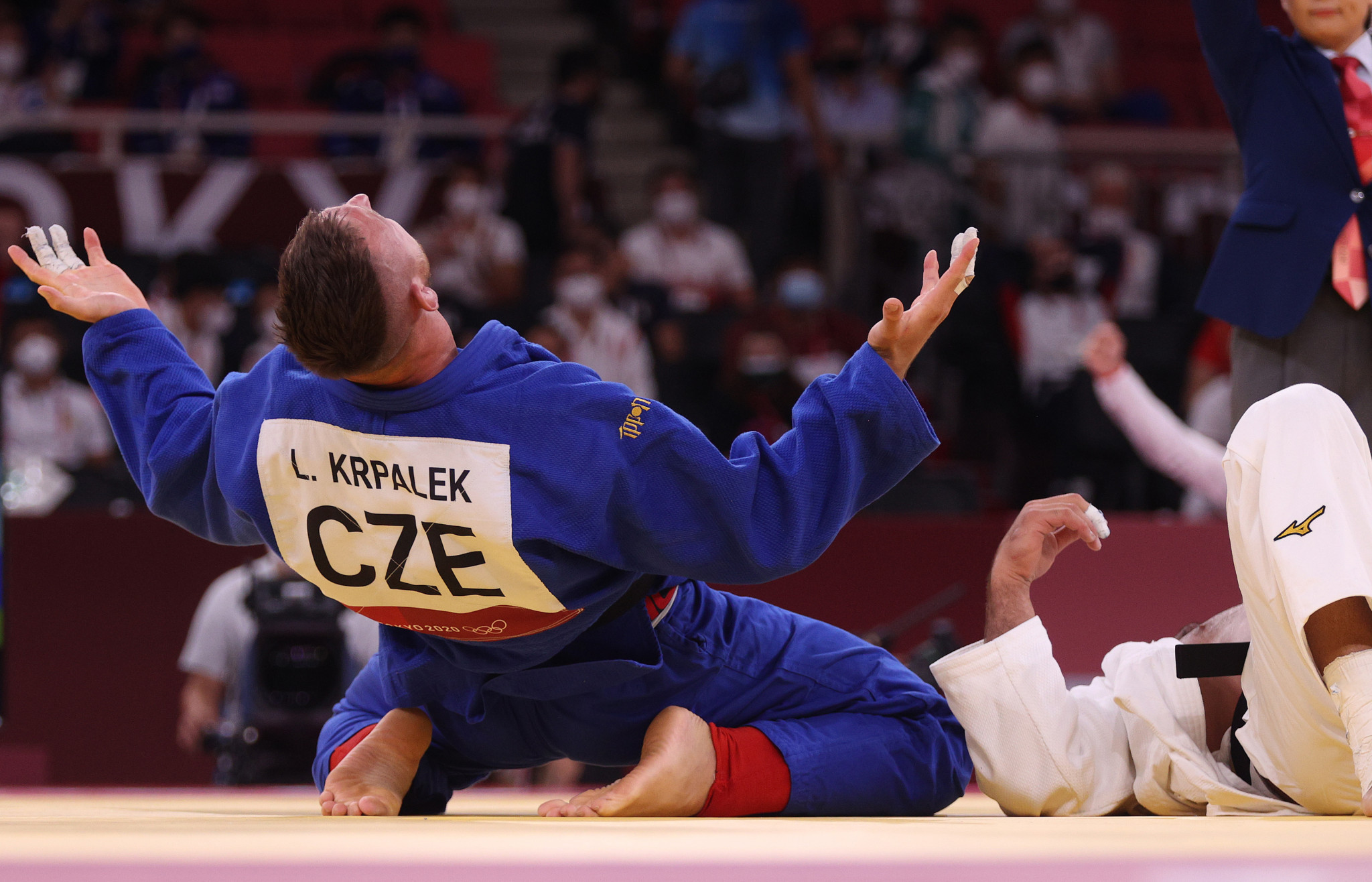 Lukáš Krpálek of the Czech Republic celebrates after becoming an Olympic judo champion at two different weights, winning the men's +100 kilograms category today in Tokyo ©Getty Images