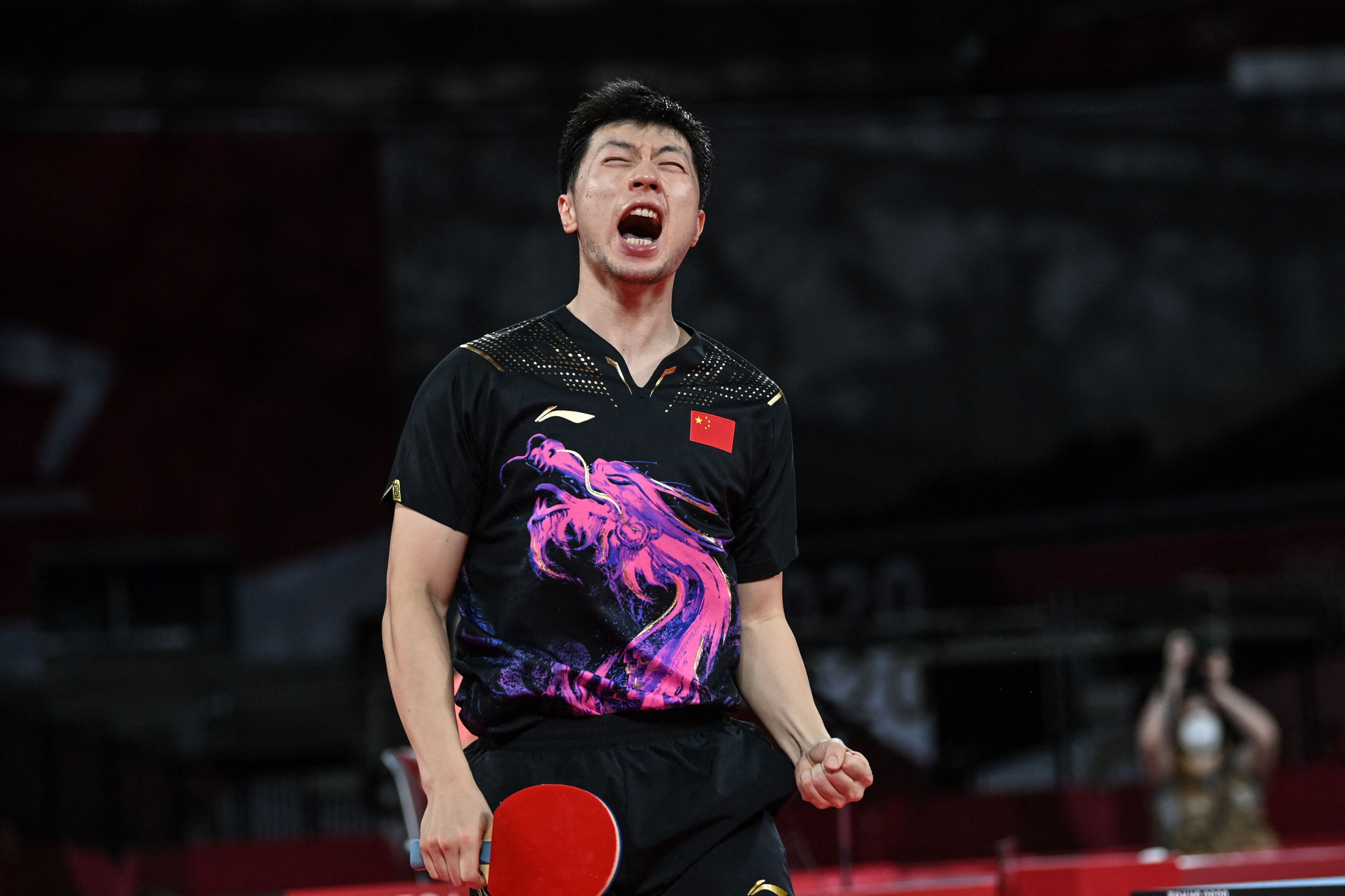 Ma Long roars with delight after winning the Olympic men's singles title for the second time ©Getty Images