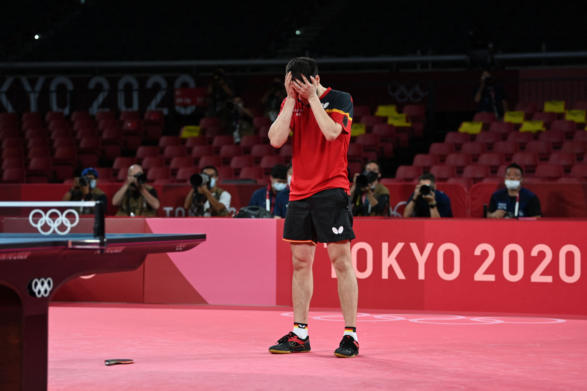 Dimitrij Ovtcharov looks in shock after saving four matches points to beat Lin Yun-Ju in a marathon bronze medal match ©Getty Images