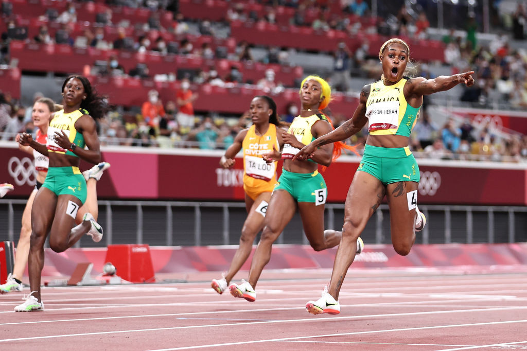 Elaine Thompson-Herah reacts in leading home a sweep of the medals for Jamaica in the women's 100m final ©Getty Images