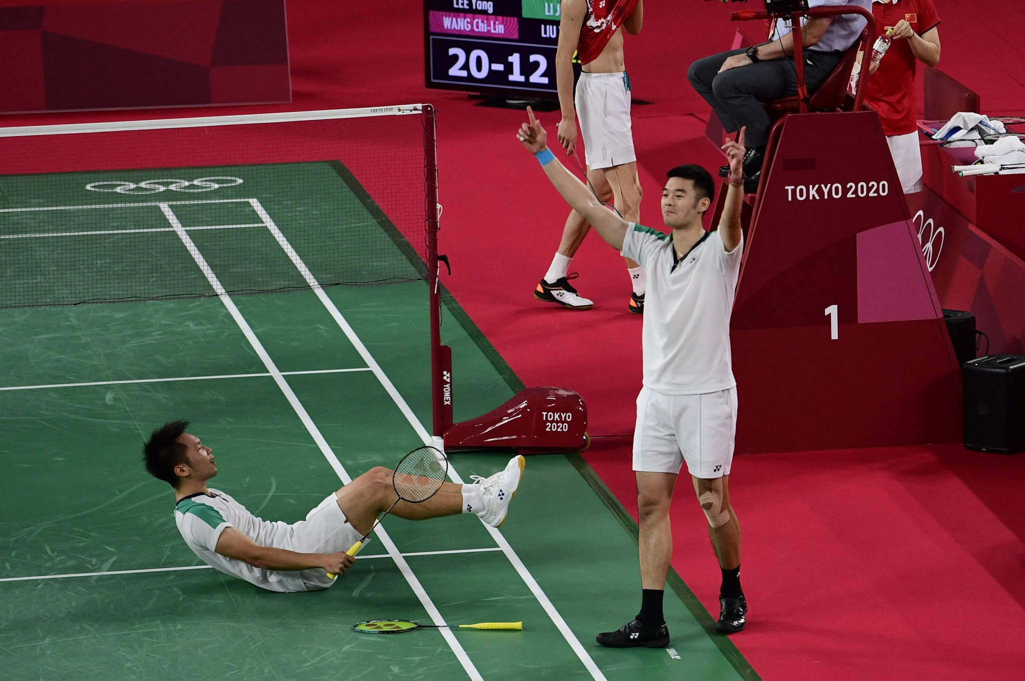 Lee Yang and Wang Chi-lin celebrate after winning the men's doubles final in straight sets ©Getty Images
