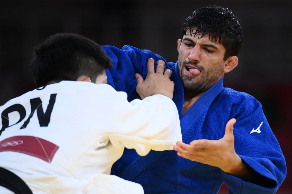 Lasha Shavdatuashvili, blue, was also found to have broken the COVID-19 rules in place at Tokyo 2020 ©Getty Images