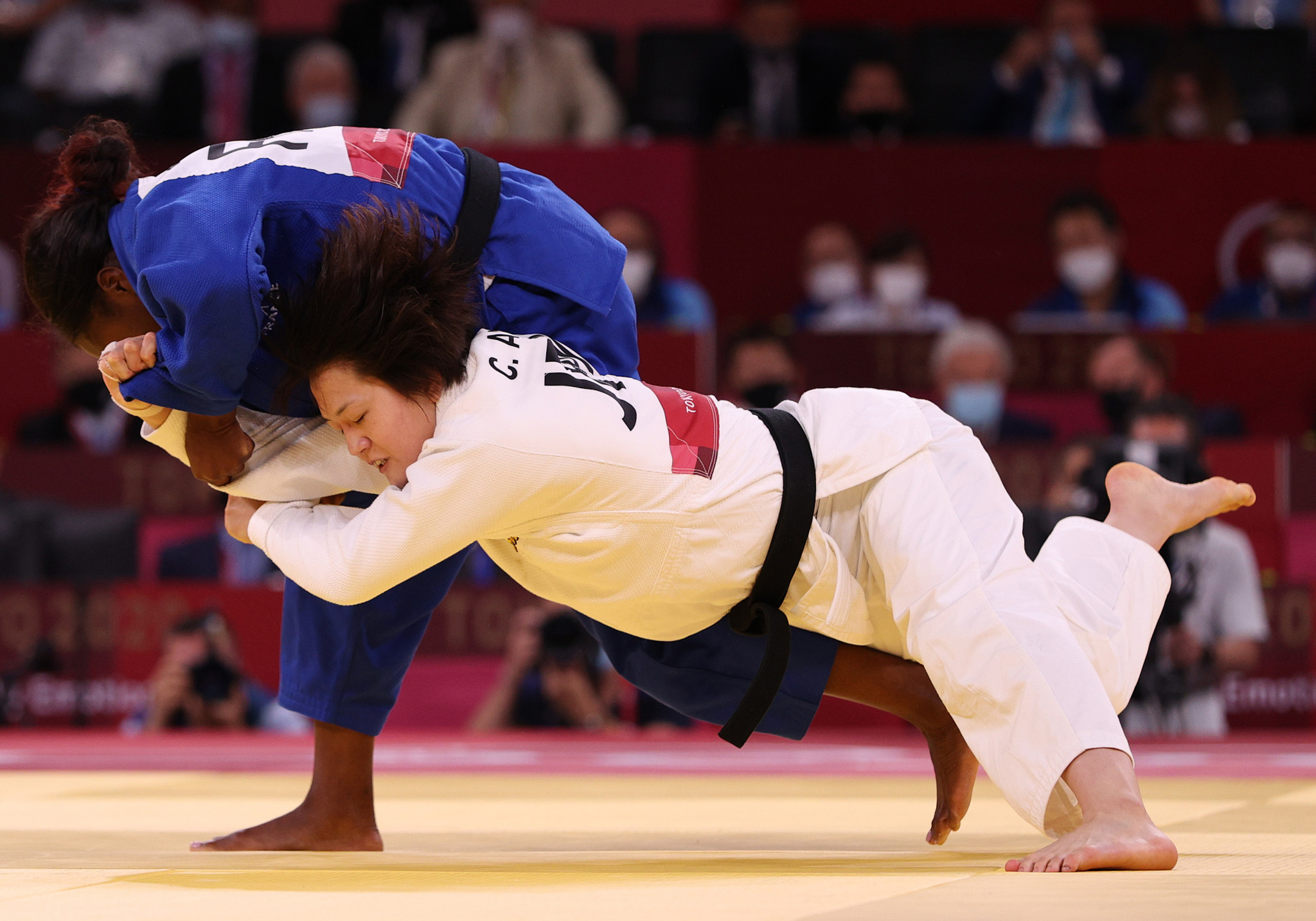 Clarisse Agbegnenou of France, pictured in blue, was among the French judoka to win in the mixed team event ©Getty Images