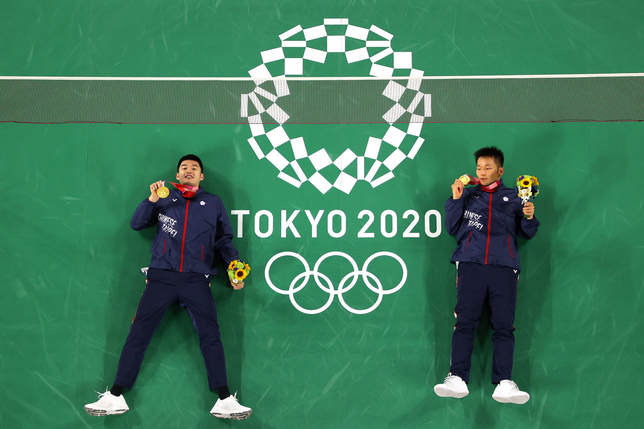 Wang Chi-Lin (left) and Lee Yang with their medals after winning the men's doubles badminton title in four games ©Getty Images