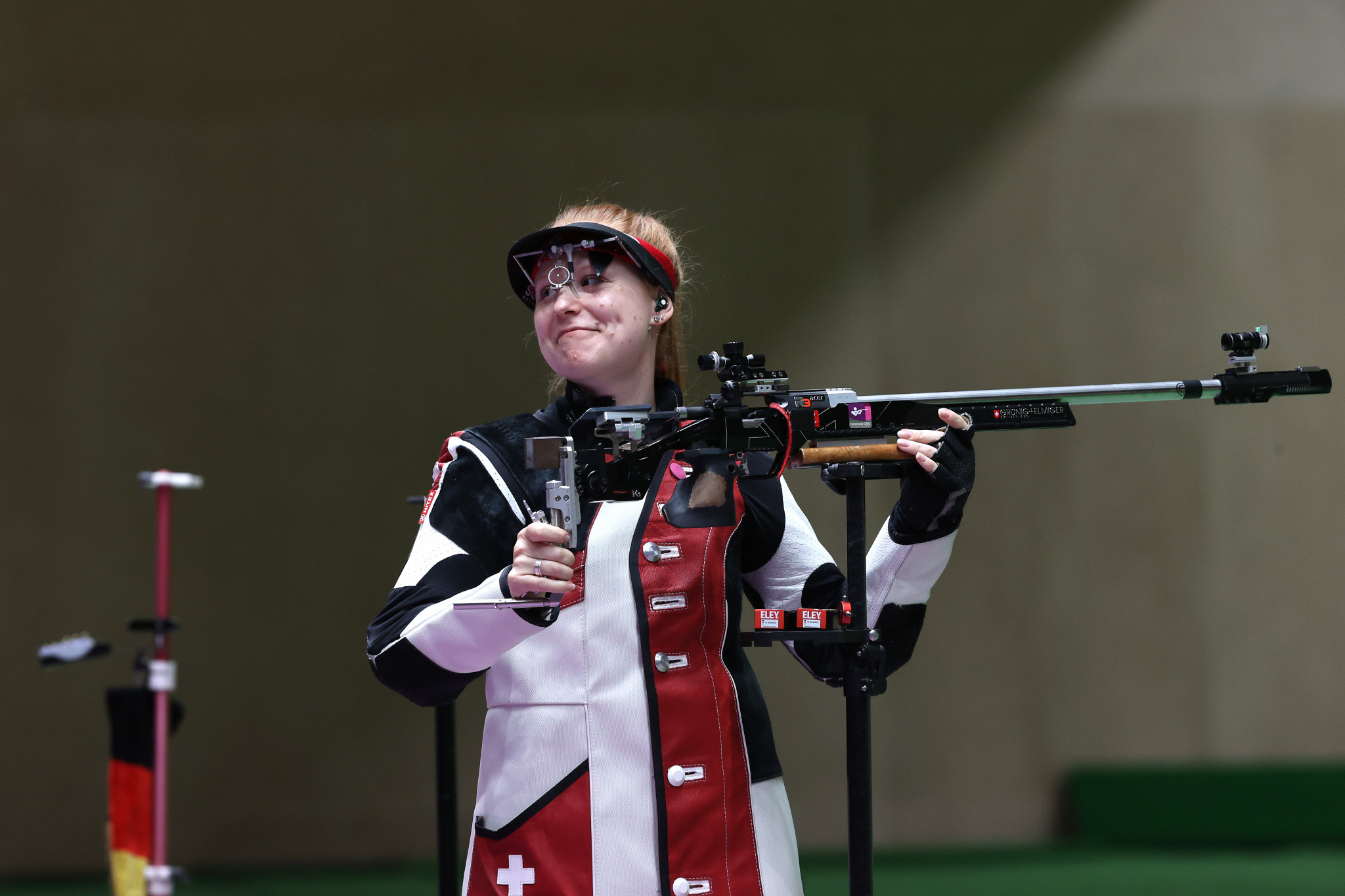 Nina Christen of Switzerland is all smiles after taking gold in the women's 50m rifle 3 positions event ©Getty Images