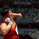 Gong sets personal best to add Olympic women's shot put gold to world titles