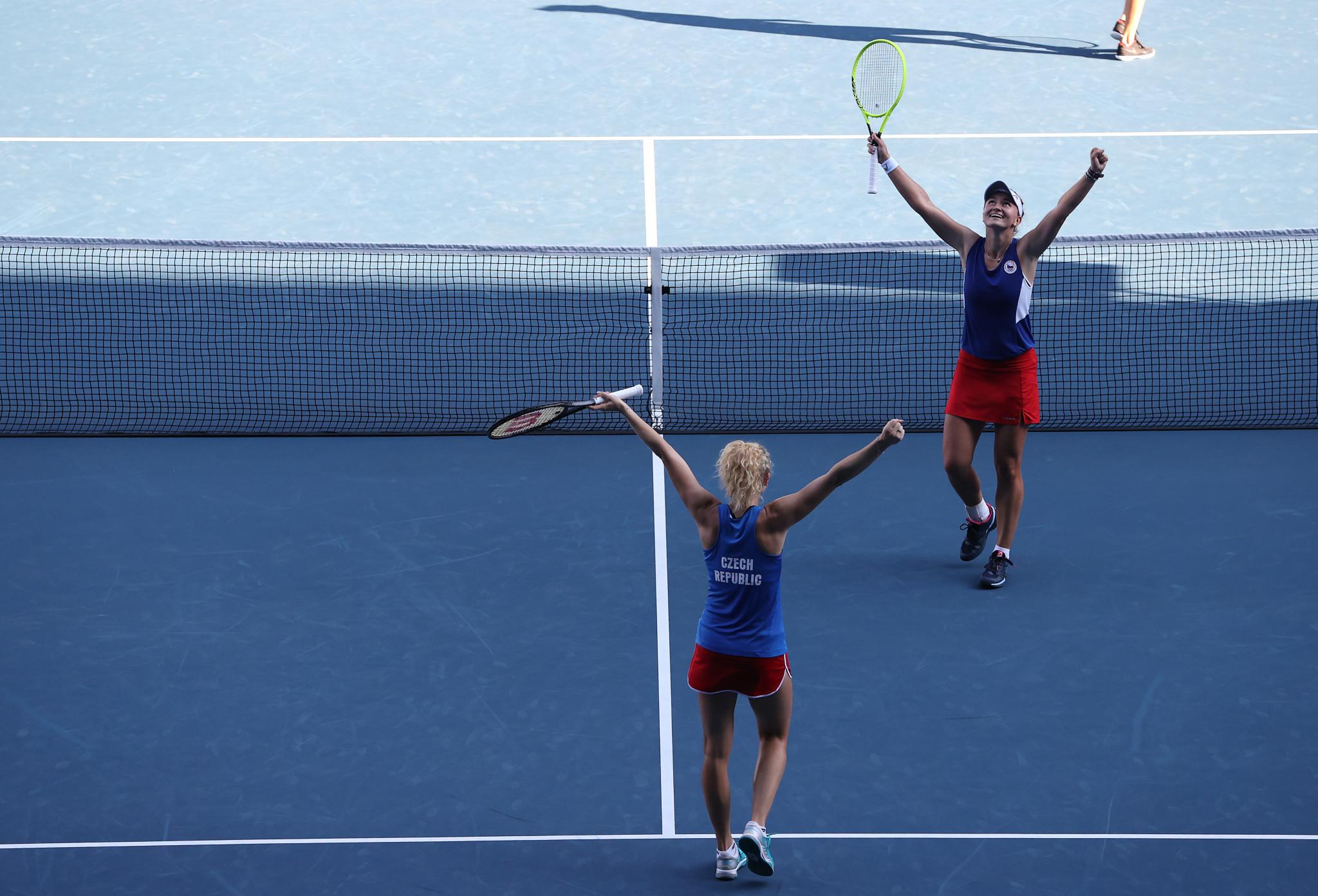 Barbora Krejčíková and Kateřina Siniaková celebrate after securing the women's doubles crown ©Getty Images