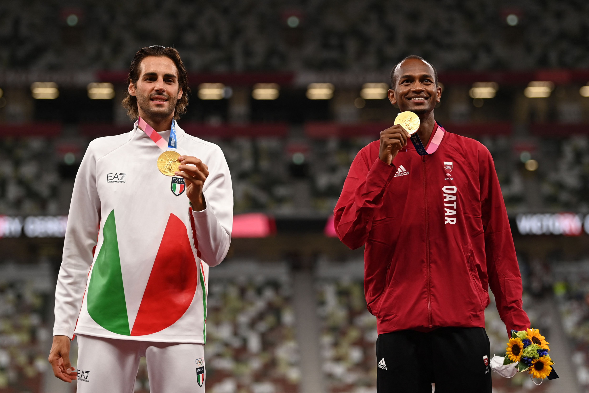 Gianmarco Tamberi, left, and Mutaz Barshim, right, share high jump gold at the Tokyo 2020 Olympics ©Getty Images