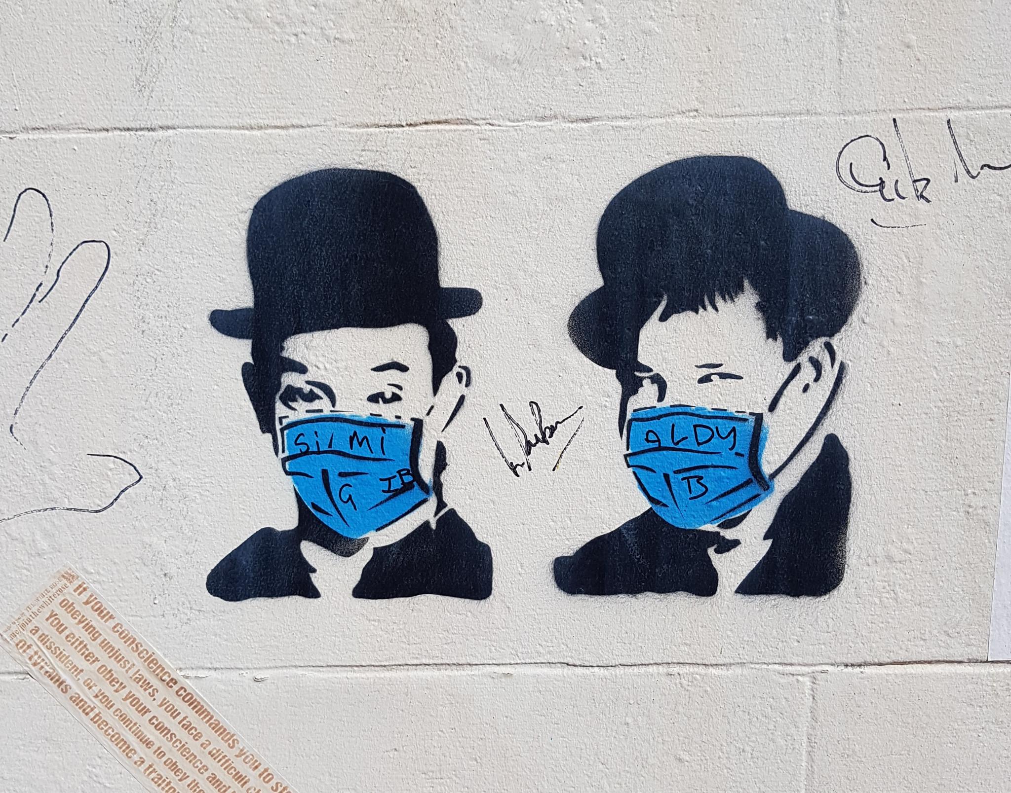 Pandemic-themed Laurel and Hardy graffiti seen in Ulverston ©David Owen
