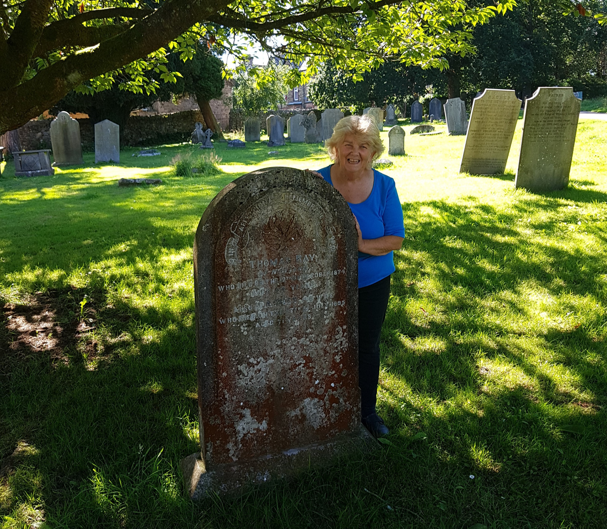 Local historian Jennifer Snell at grave of vaulter Tom Ray's parents in Ulverston churchyard ©David Owen