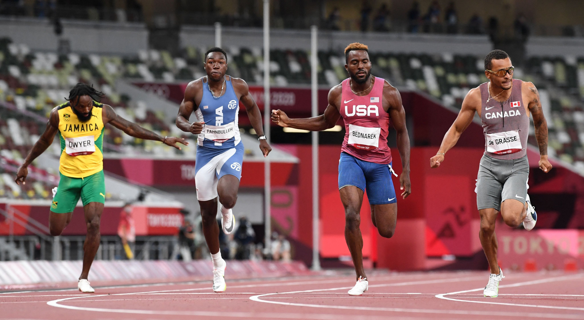 And Canada's Andre De Grasse, right, won the last gold medal of the day, winning the men's 200m ahead of American Kenny Bednarek, second right, by 0.06sec ©Getty Images