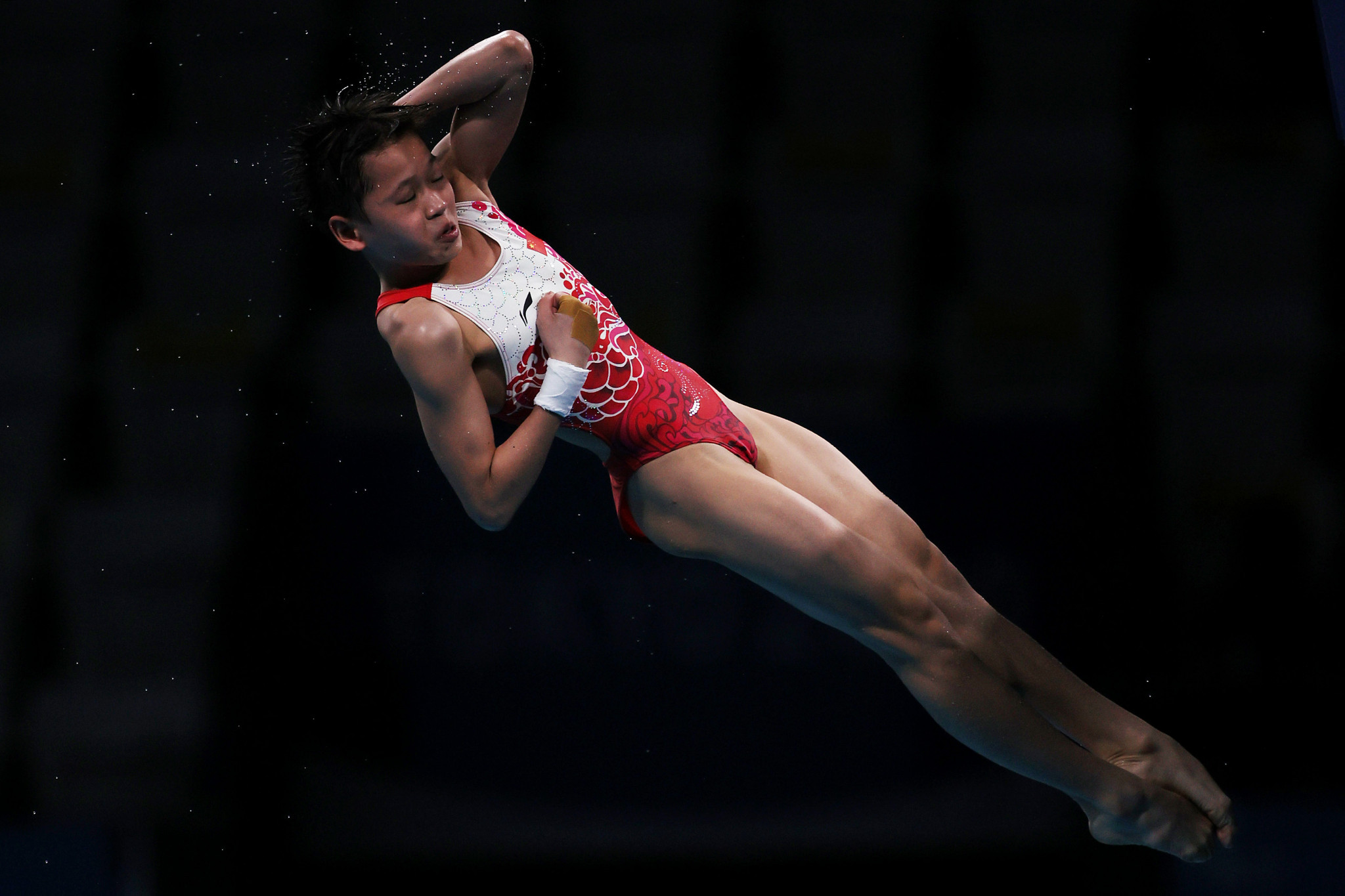 Quan in class of her own as 14-year-old dives to women's 10m platform gold at Tokyo 2020