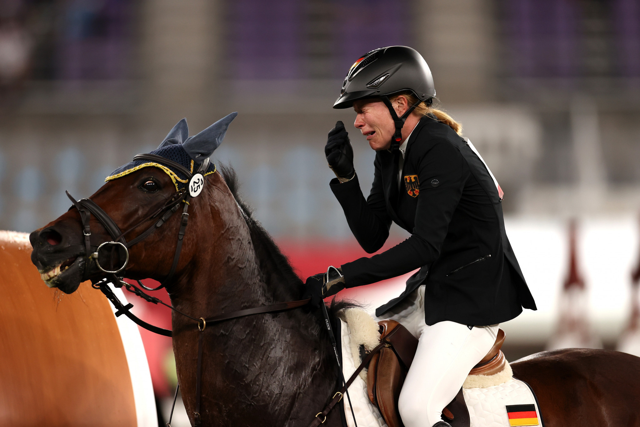 Germany's Annika Schleu broke down in tears after Saint Boy refused to jump in the riding event of the modern pentathlon ©Getty Images