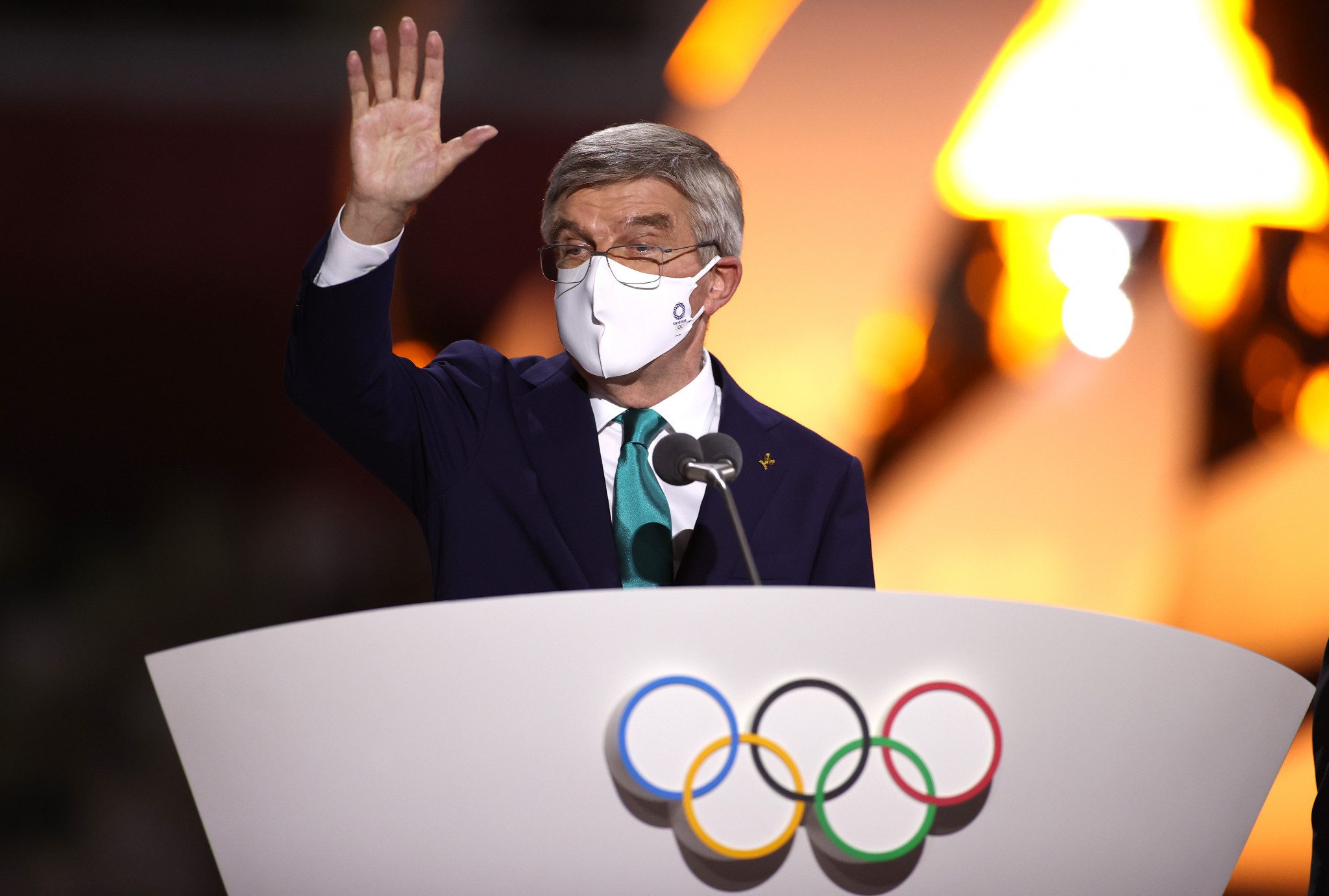 Questions asked after IOC President Bach seen walking around Tokyo's Ginza district after Olympics