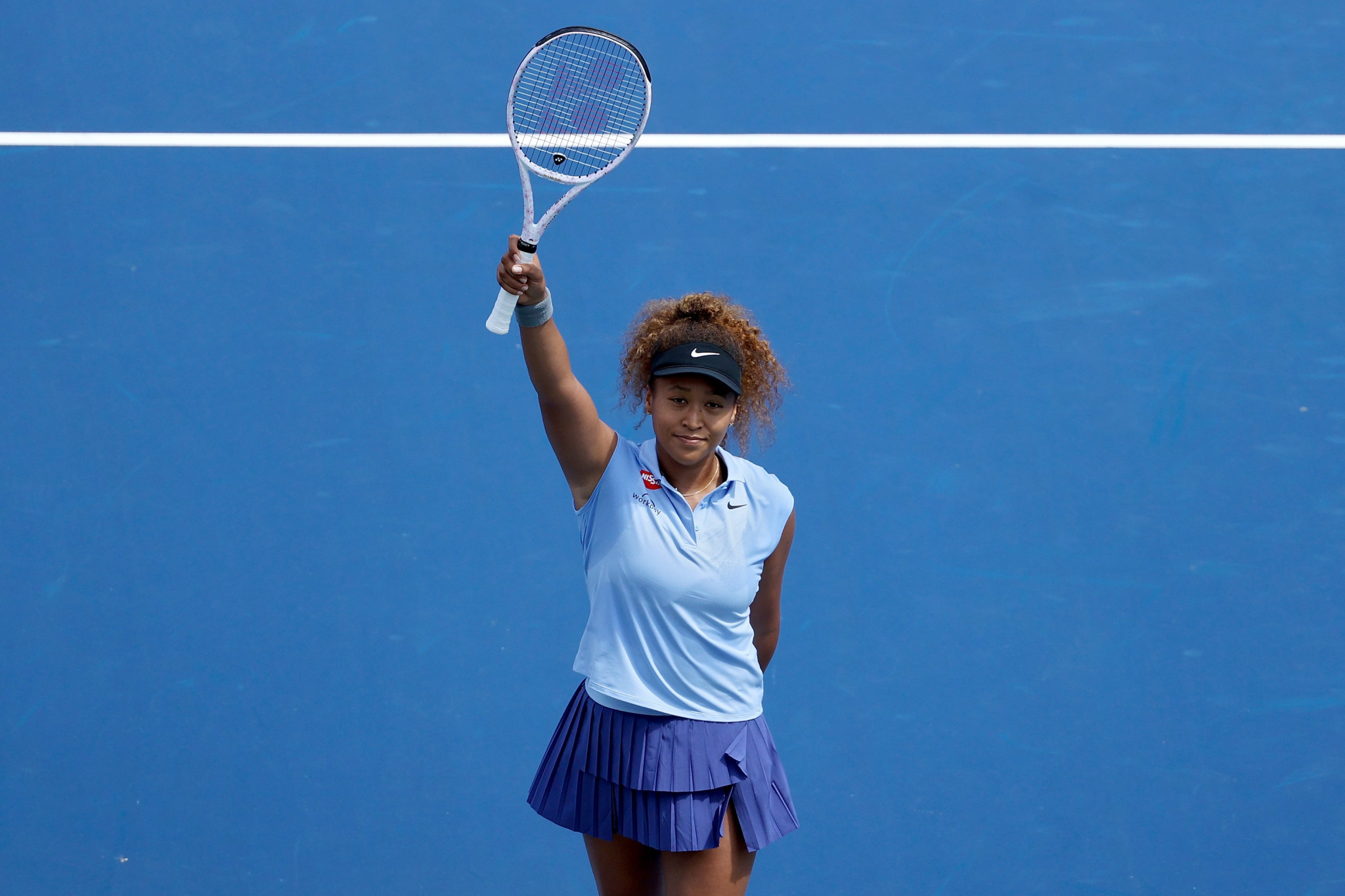 Naomi Osaka celebrates after beating Coco Gauff in a trick second-round battle ©Getty Images