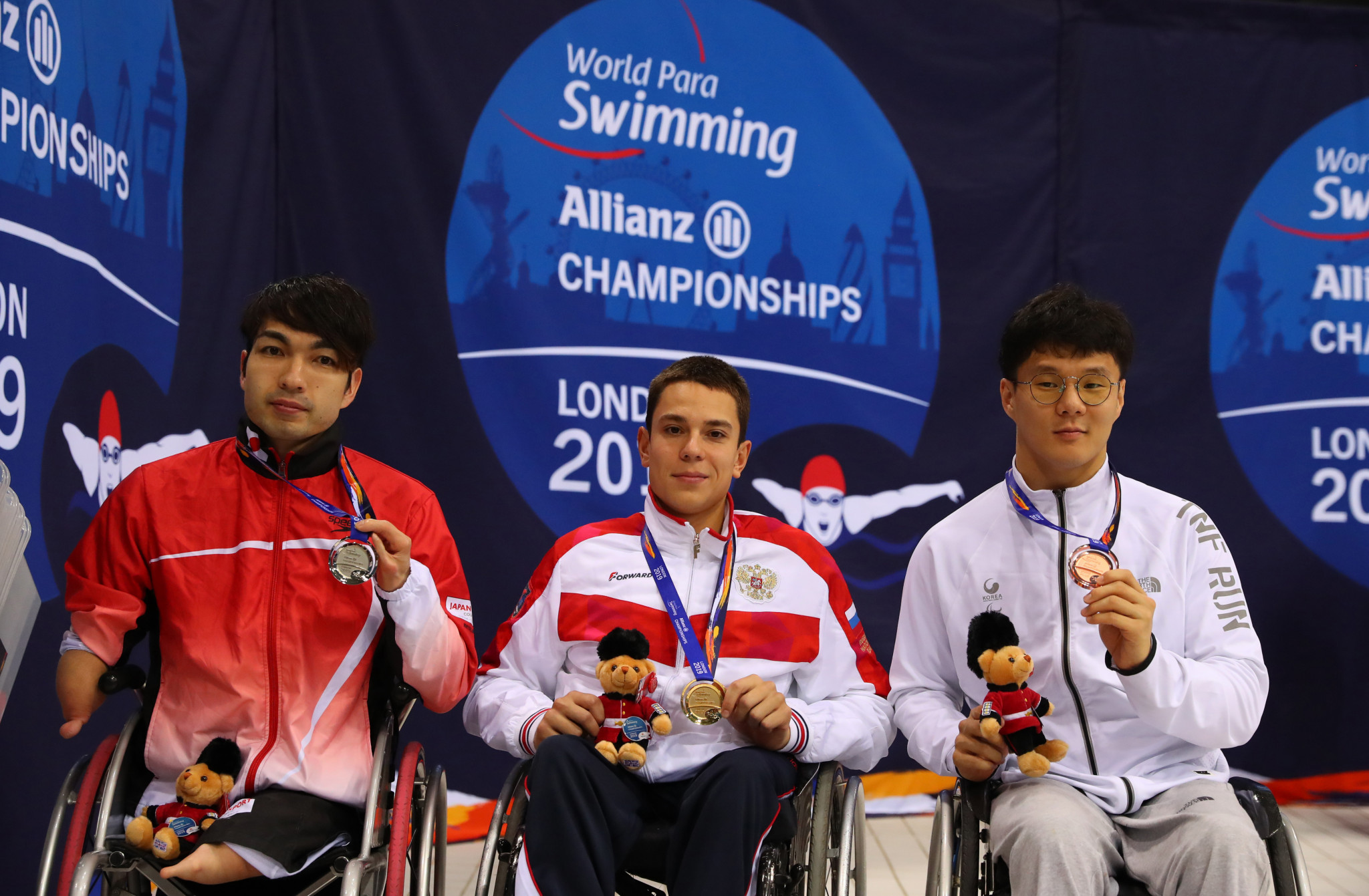 Roman Zhdanov, centre, also won three gold medals at the World Para Swimming Championships in London in 2019 ©Getty Images
