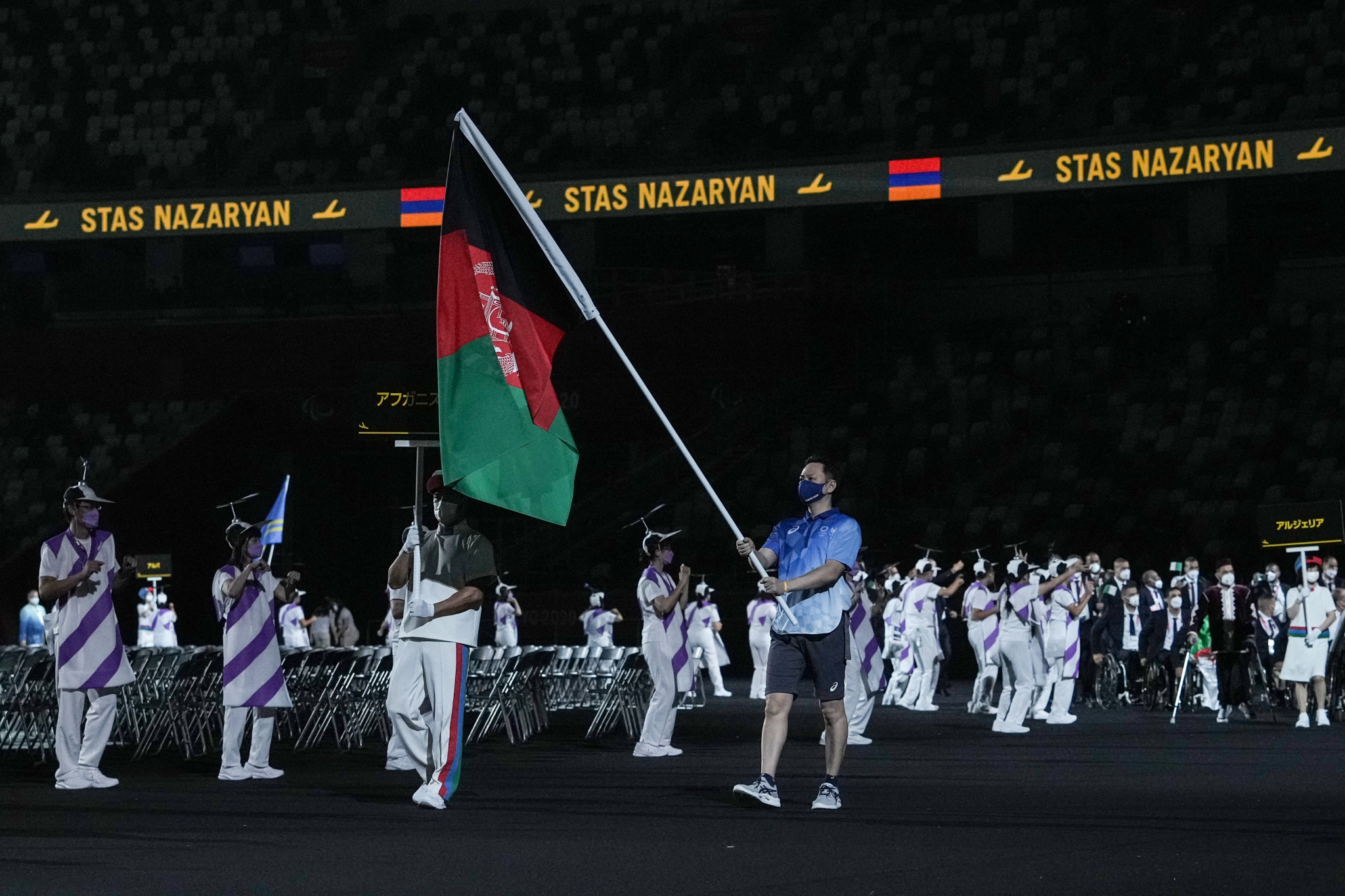 A Tokyo 2020 volunteer carried the Afghanistan flag during the Parade of Nations ©Getty Images