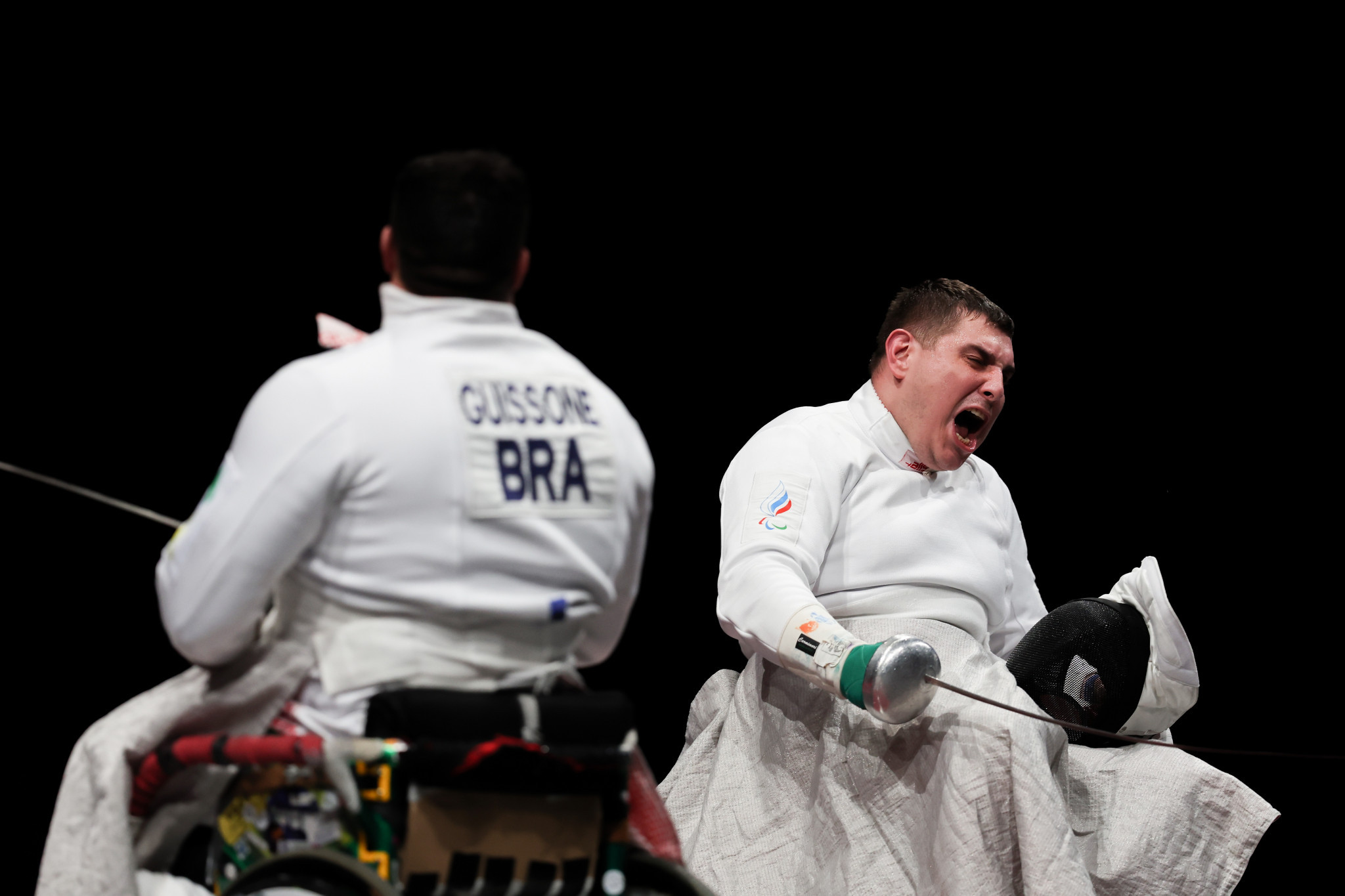 Alexander Kuzyukov, right, celebrates after a 15-8 gold medal bout victory against Jovane Guissone ©Getty Images