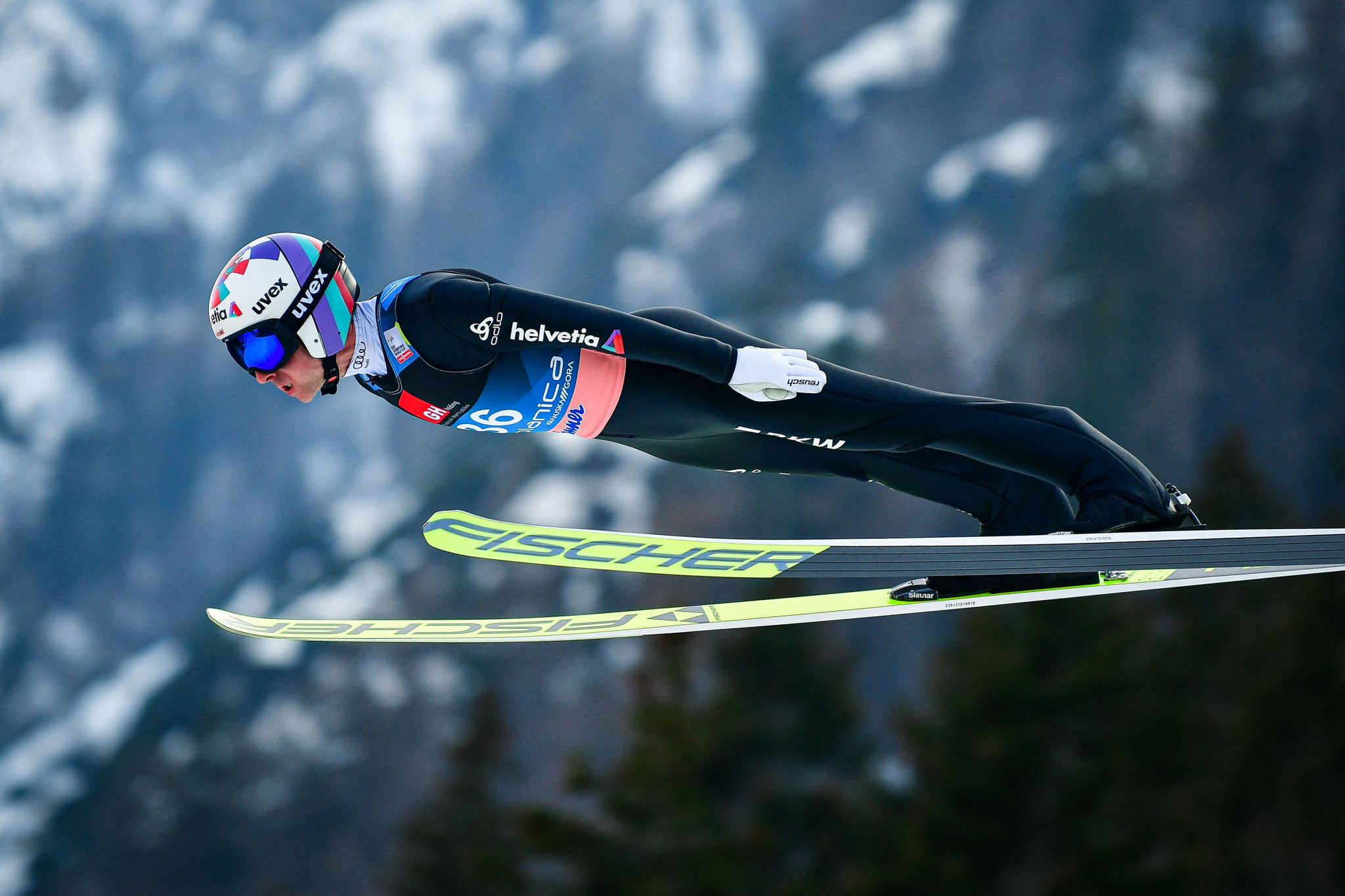 Four-time Olympic champion Ammann tears foot ligament but does not need surgery