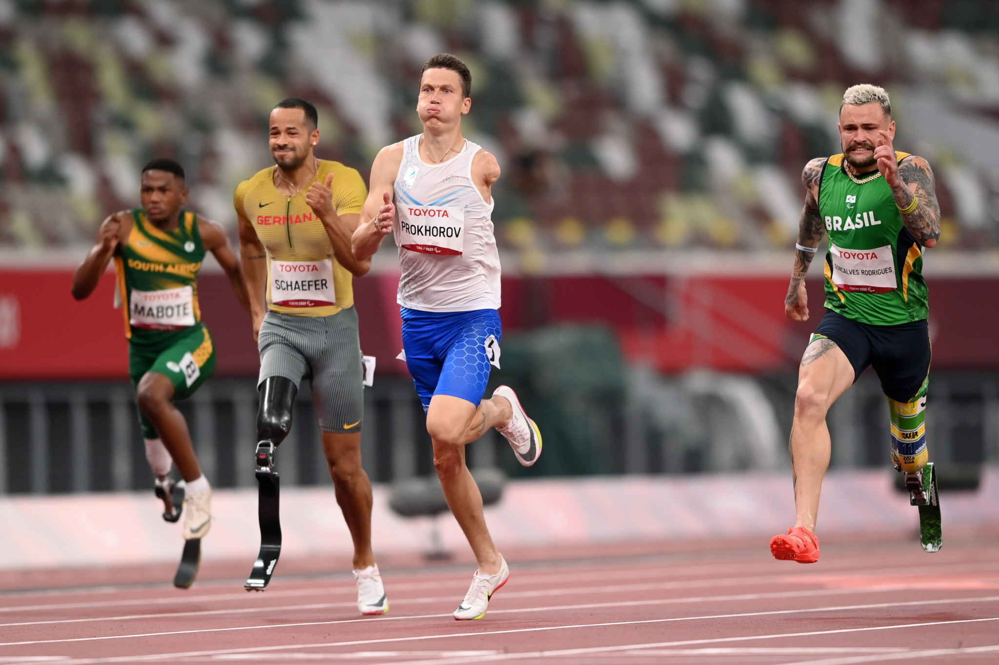 Anton Prokhorov, centre, had to hold off a late surge by Vinicius Goncalves Rodrigues, right, eventually winning gold by 0.01 seconds ©Getty Images