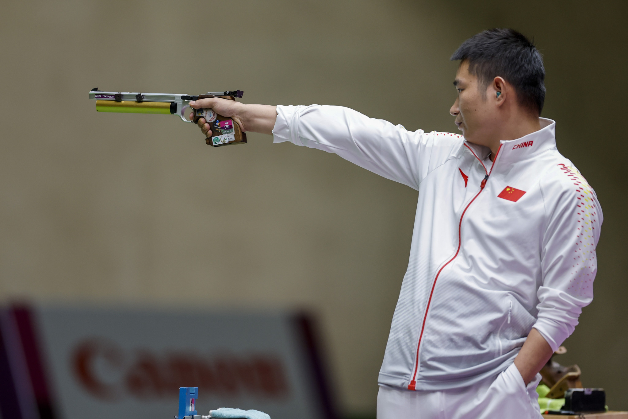 Huang bounces back to retain pistol gold with Paralympic record