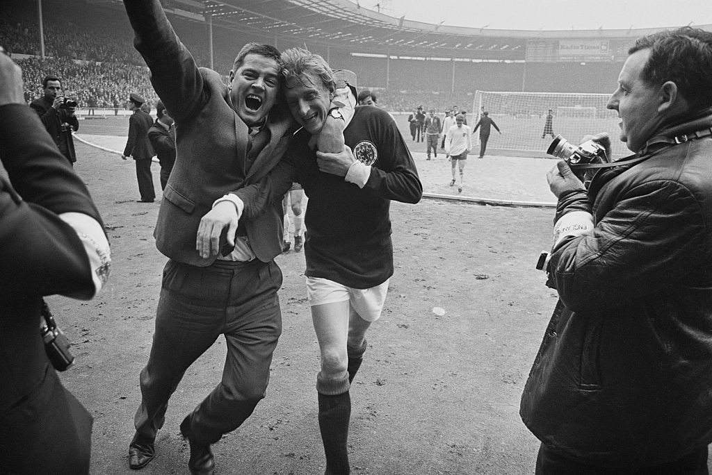 Denis Law is hugged by a fan after Scotland's 3-2 win over World Cup winners England at Wembley in 1967 ©Getty Images