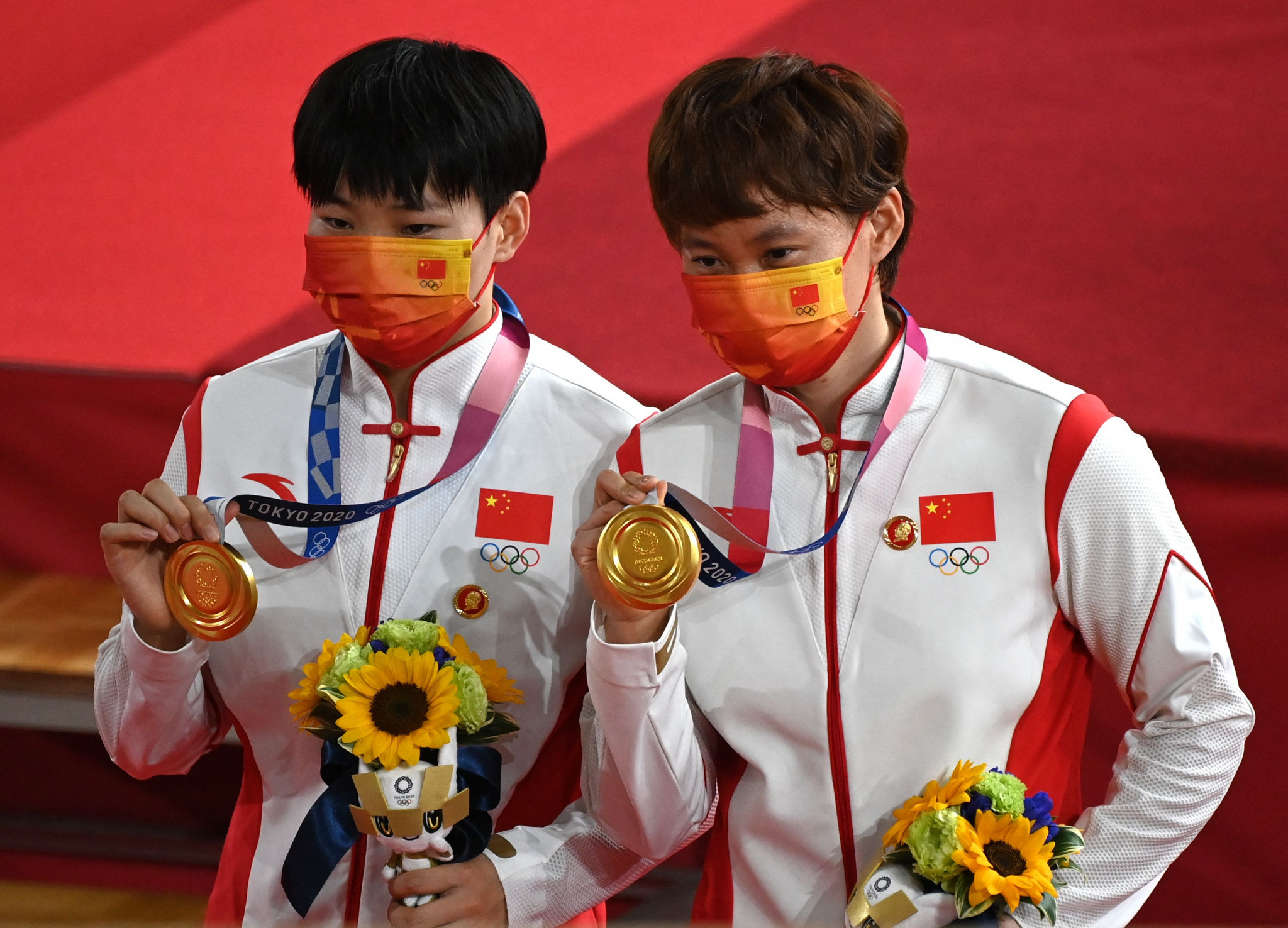 Chinese cyclists were warned at Tokyo 2020 for wearing badges on the podium featuring the head of their country's former leader Mao Zedong - a violation of the IOC's Rule 50 ©Getty Images