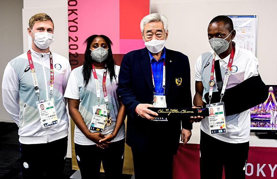 Choue presents black belt to refugee taekwondo athlete Hakizimana