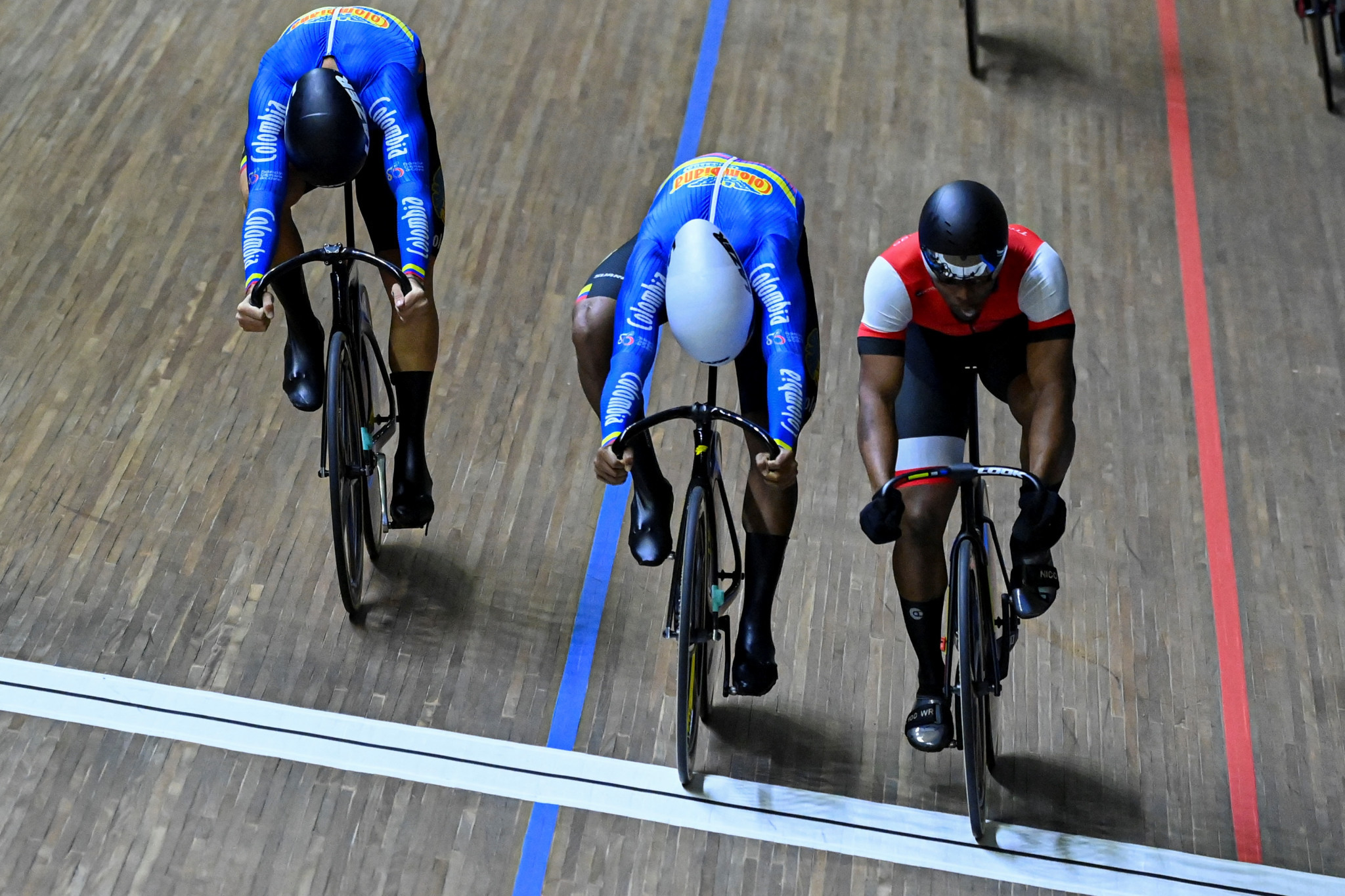Nicholas Paul, right, pipped two Colombian riders to victory in the men's keirin to win his second gold in Cali ©Getty Images
