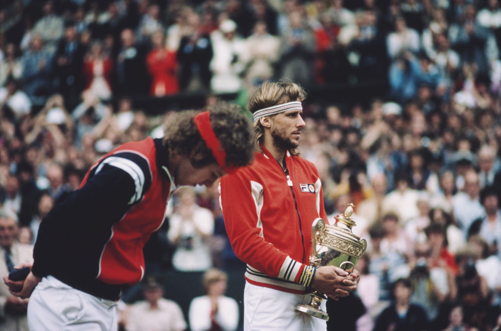 Bjorn Borg clutches the Wimbledon men's trophy for a sixth successive time after his win in an epic five-set final against John McEnroe during which he felt his old armour of invincibility buckle...©Getty Images