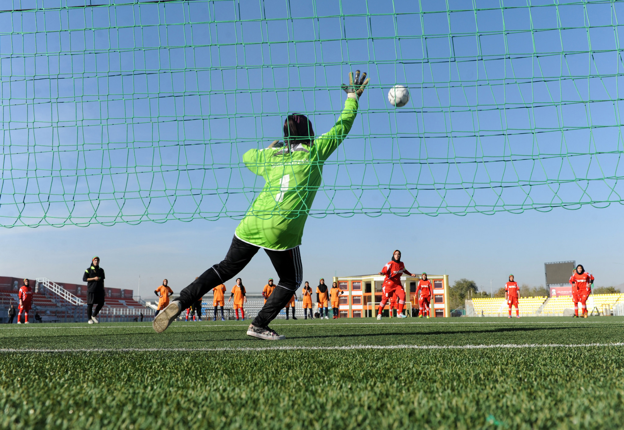 Afghanistan women's youth football players and families flee to Pakistan