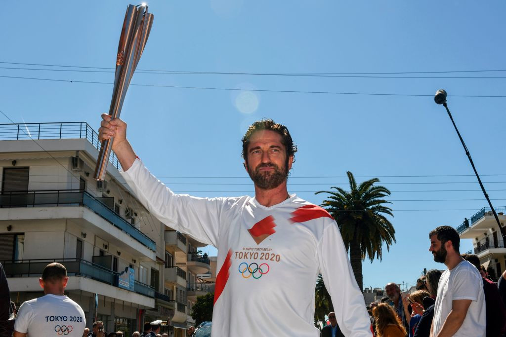 Gerard Butler carried the Tokyo 2020 Flame in Greece last year ©Getty Images