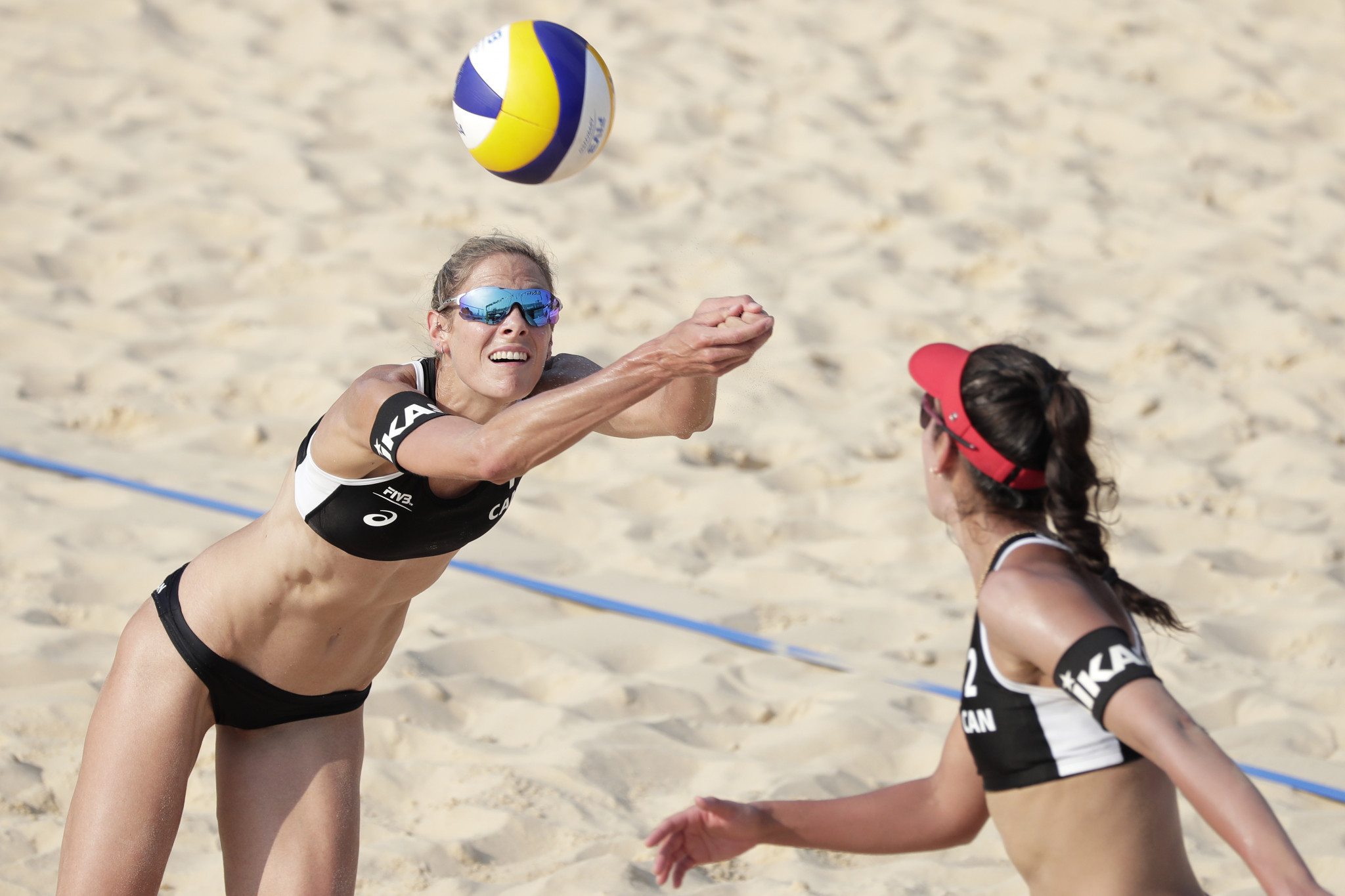 Sarah Pavan, left, and Melissa Humana-Paredes, right, won the women's FIVB Beach Volleyball World Championship in 2019 ©Getty Images