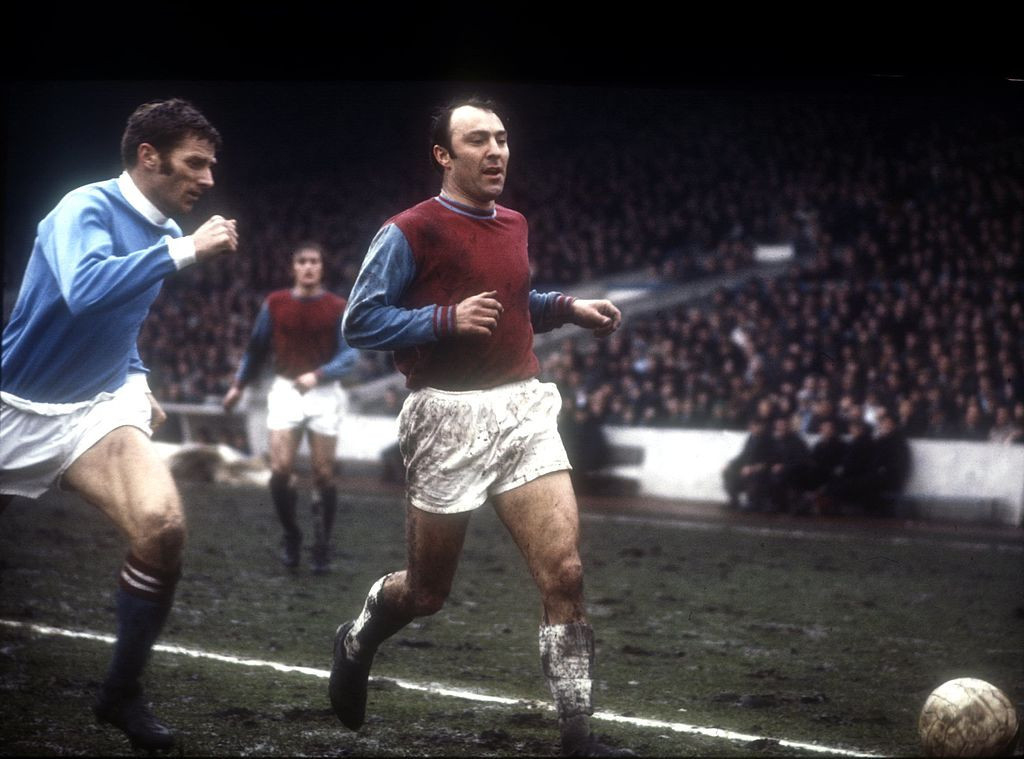 Jimmy Greaves pictured with Manchester City's Tony Book while making his West Ham United debut in 1970 ©Getty Images