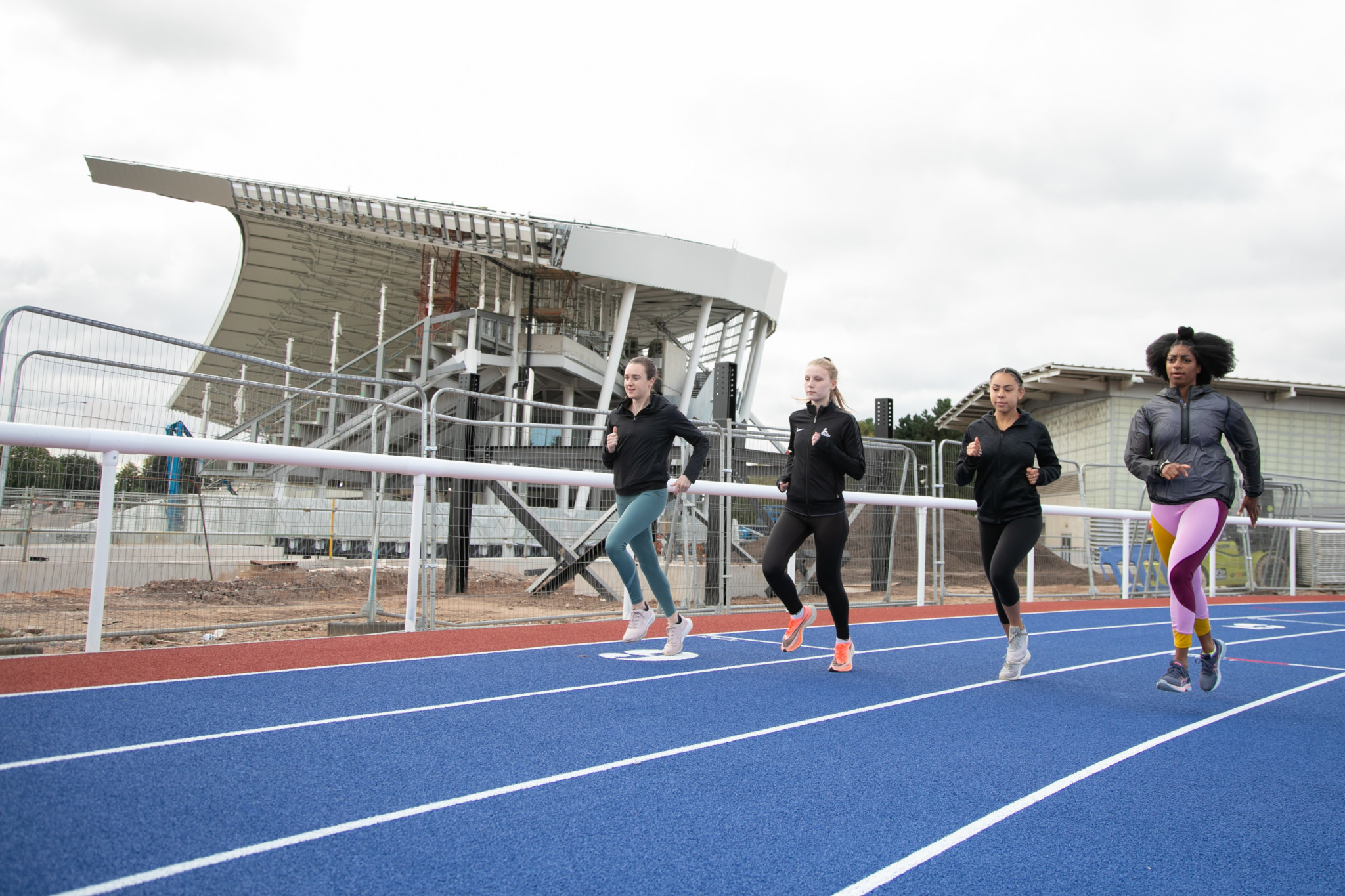 Athletes including Laura Muir, left, and Kadeena Cox, right, run on the athletics track at the Alexander Stadium, which is currently undergoing renovation ©Birmingham 2022