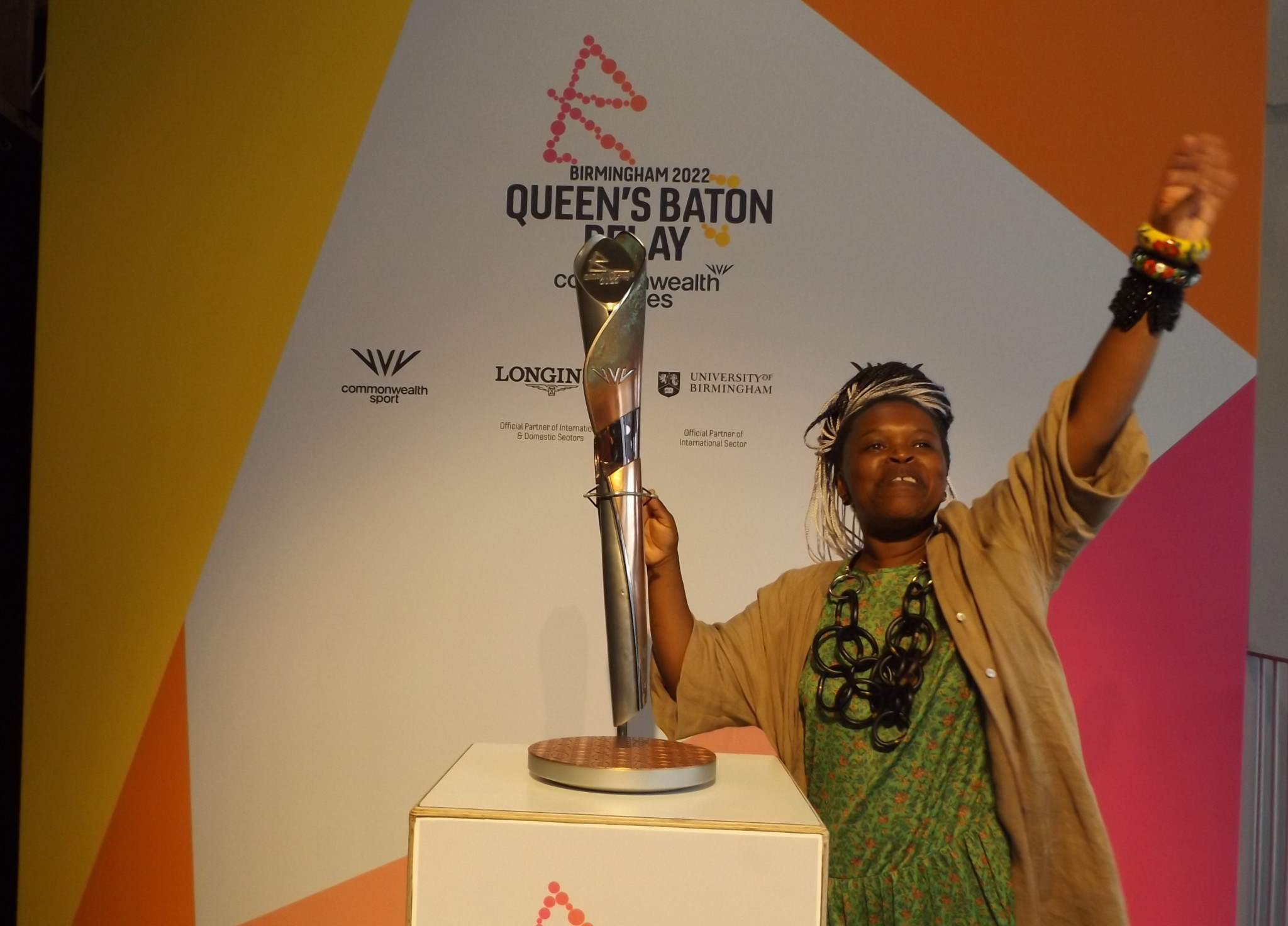 Laura Nyahuye, who led the design process, poses with the Birmingham 2022 Baton ©Philip Barker
