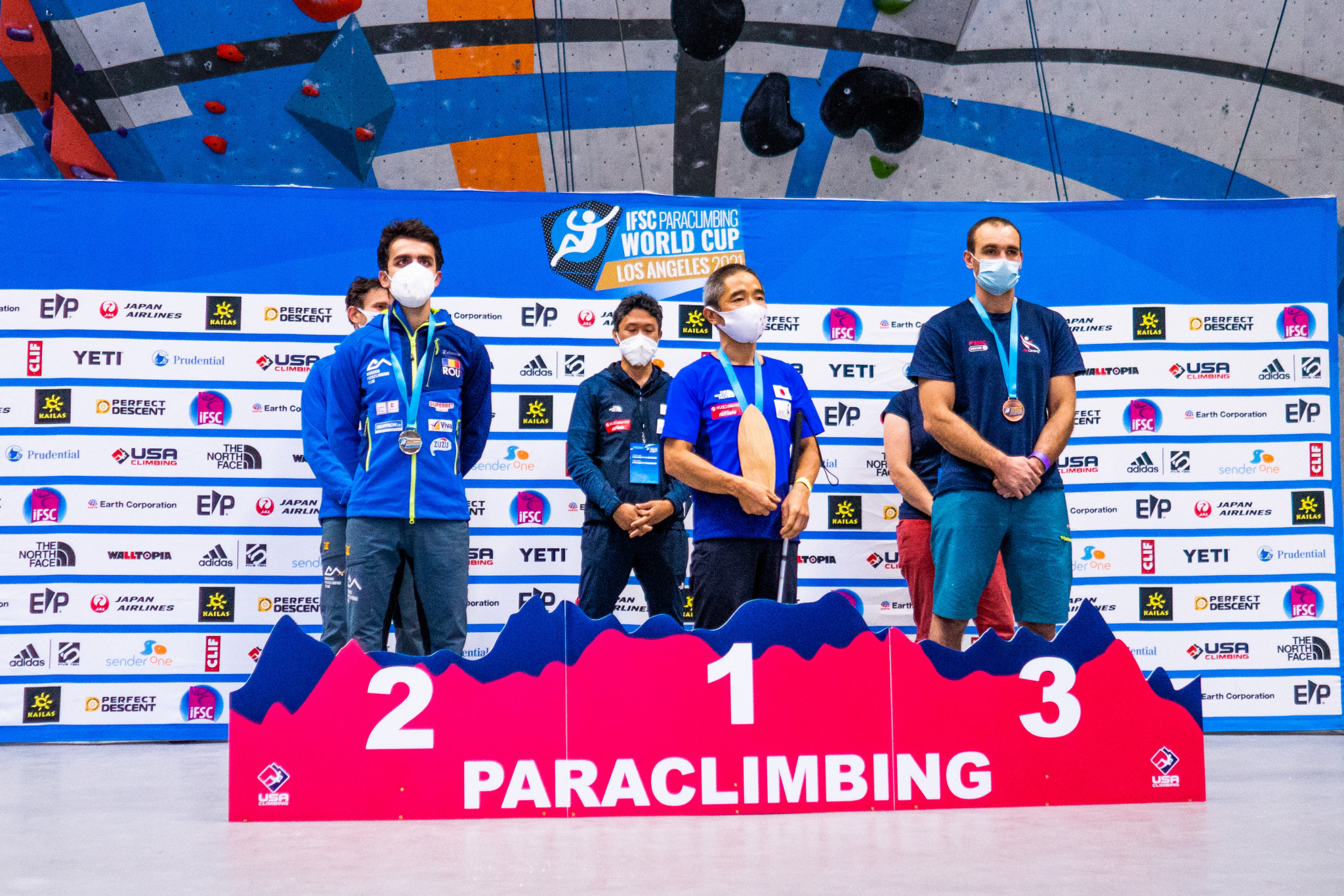 Kobayashi Koichiro, centre, won his first gold of the IFSC Paraclimbing World Cup season at the age of 53 in the men's B1 in Los Angeles ©Daniel Gajda/IFSC