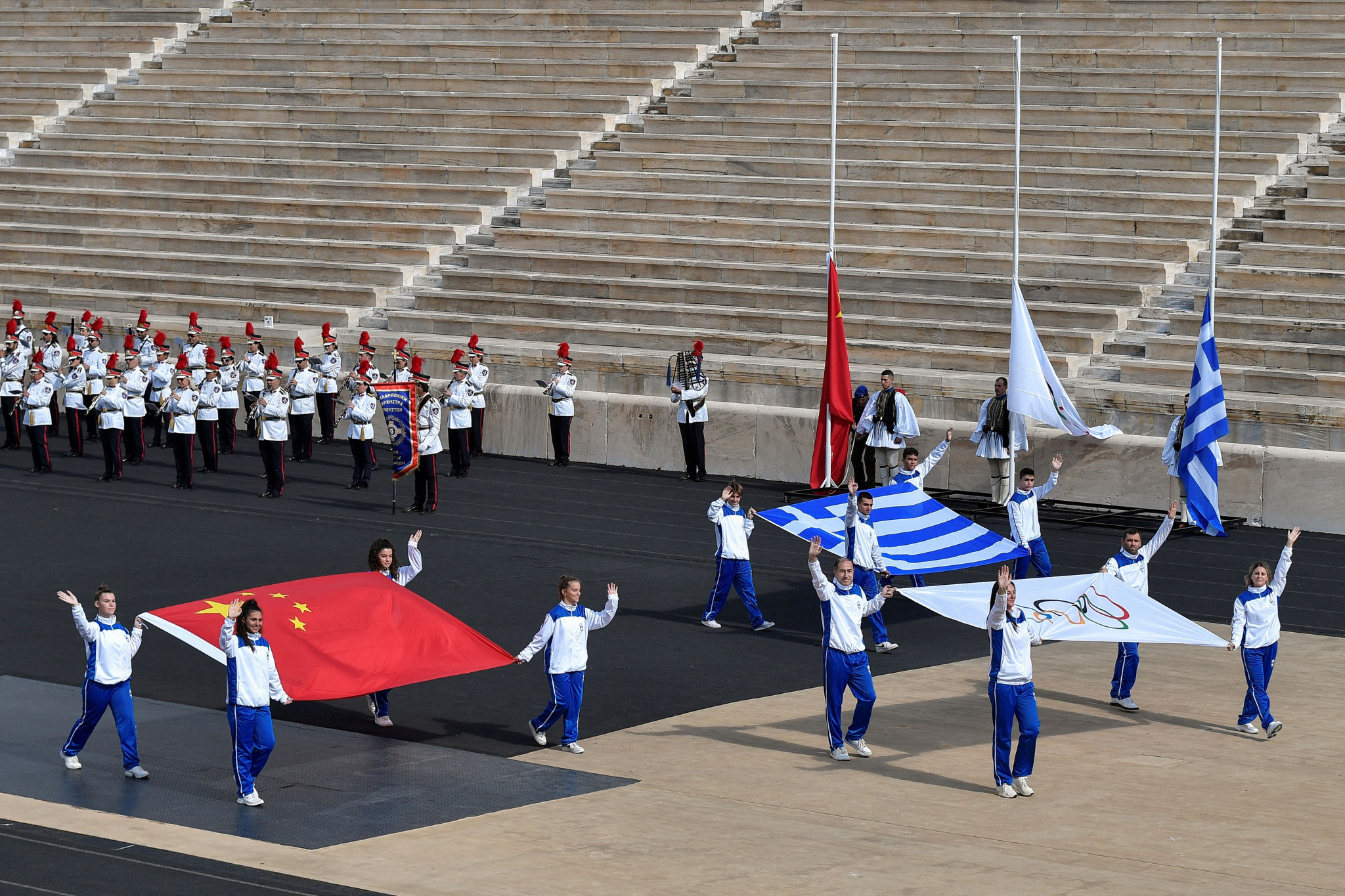 The Olympic flag, and the flags of Greece and China are carried during the Olympic Flame Handover Ceremony ©Getty Images