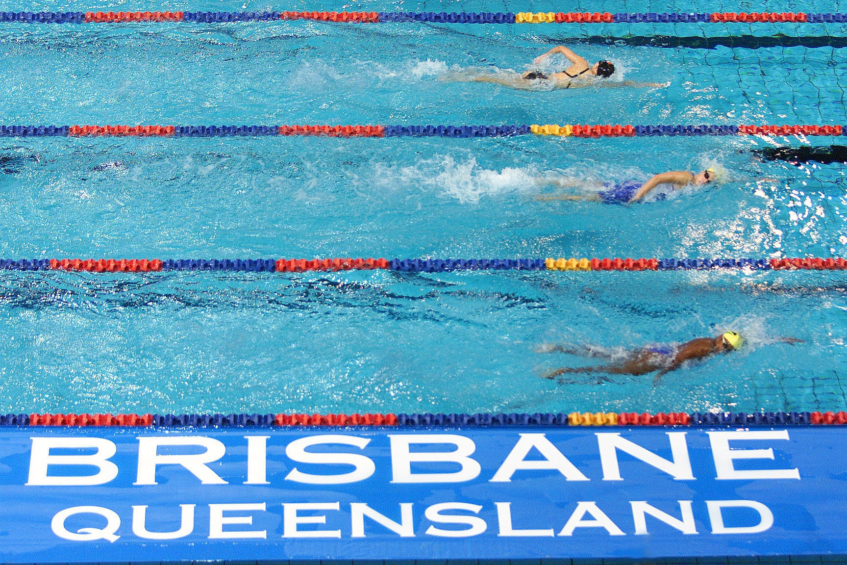 Former Australian swimming coach held in custody on historic child abuse charges