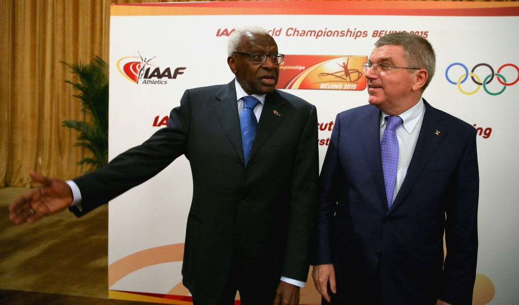 Lamine Diack (left), pictured with IOC President Thomas Bach, vacated his IOC honorary member position soon after the allegations of his wrongdoing in athletics appeared ©Getty Images