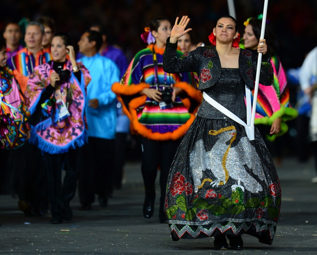Maria Espinoza, pictured carrying the Mexican flag at the Opening Ceremony of London 2012, is a major star in her home country ©AFP/Getty Images