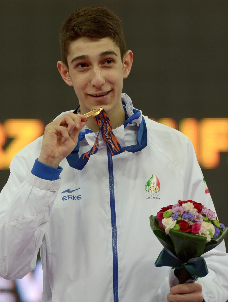 Farzan Ashour Zadeh Fallah celebrating gold at the Asian Games in Incheon ©Getty Images