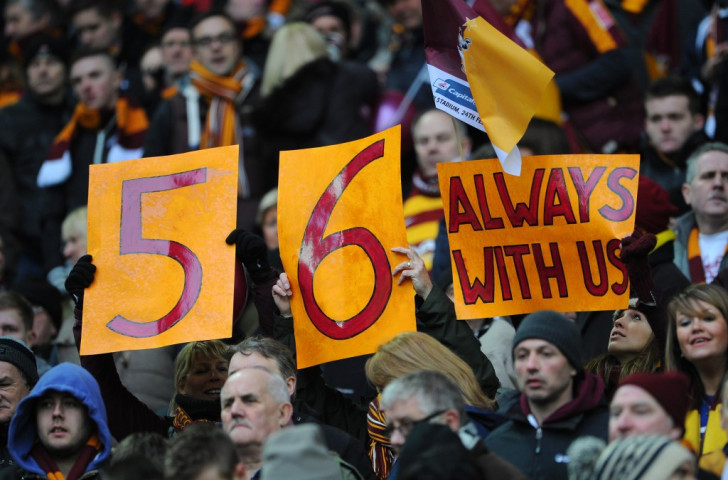 Bradford City fans at the 2013 Capital One Cup final at Wembley pay personal tribute to those who died in the 1985 fire at Valley Parade, a tragedy turned into a play called The 56 ©Getty Images