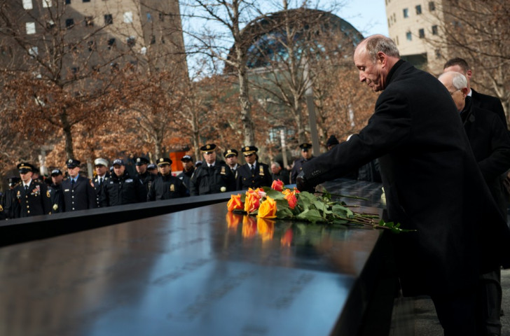 Flowers are laid at the site of the World Trade Center on the anniversary of the attack there. The events of 9-11 have generated many books, films and plays - and some questions about their morality ©Getty Images