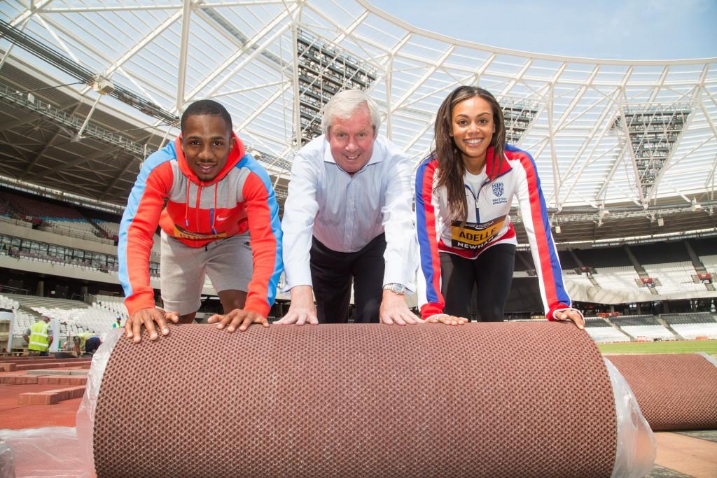 British athletics stars help lay new track at London 2012 Olympic Stadium