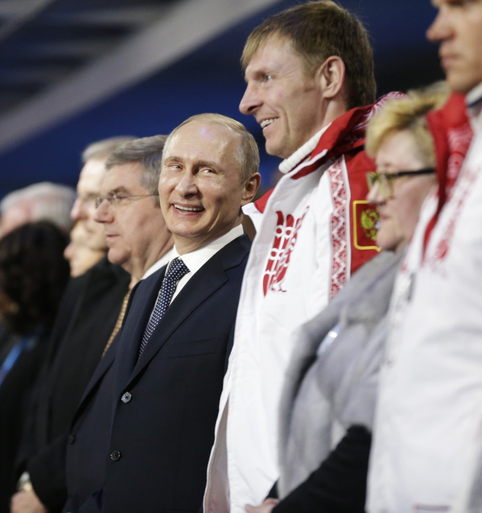 Alexander Zubkov, pictured next to Vladimir Putin and Thomas Bach at the Closing Ceremony of Sochi 2014, is among those accused of doping ©Getty Images