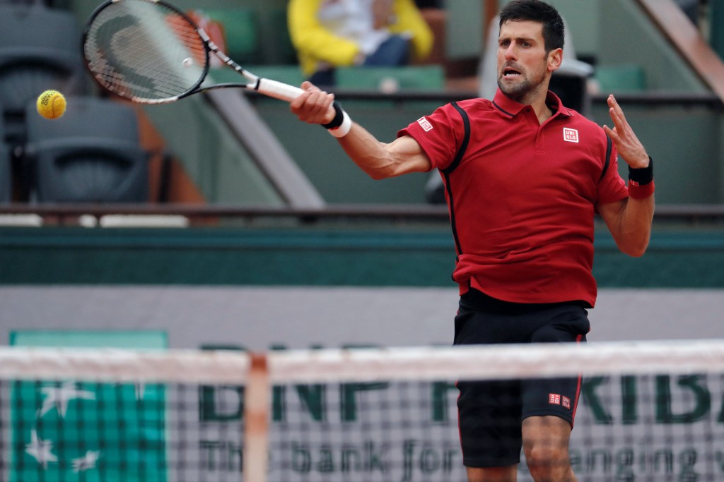 Djokovic takes fourth-round lead before rain returns at French Open