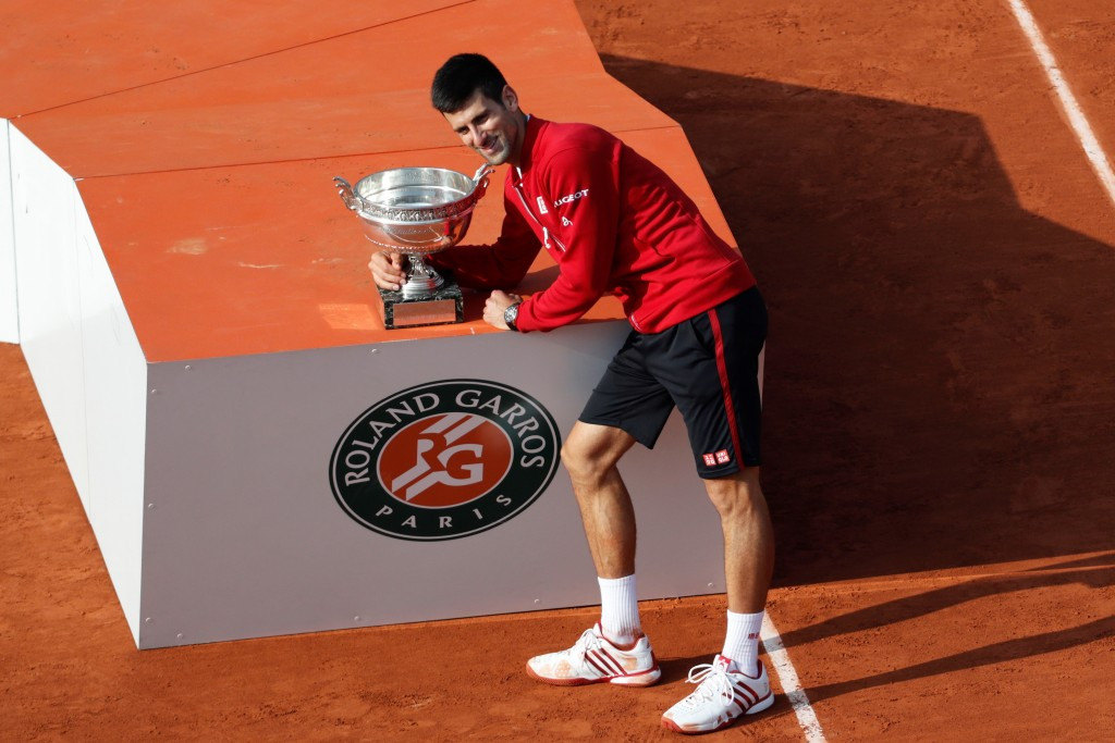 Djokovic completes career Grand Slam with French Open final victory over Murray